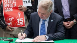 Seattle Mayor Signs Bill Raising City's Minimum Wage To 15 Dollars An Hour